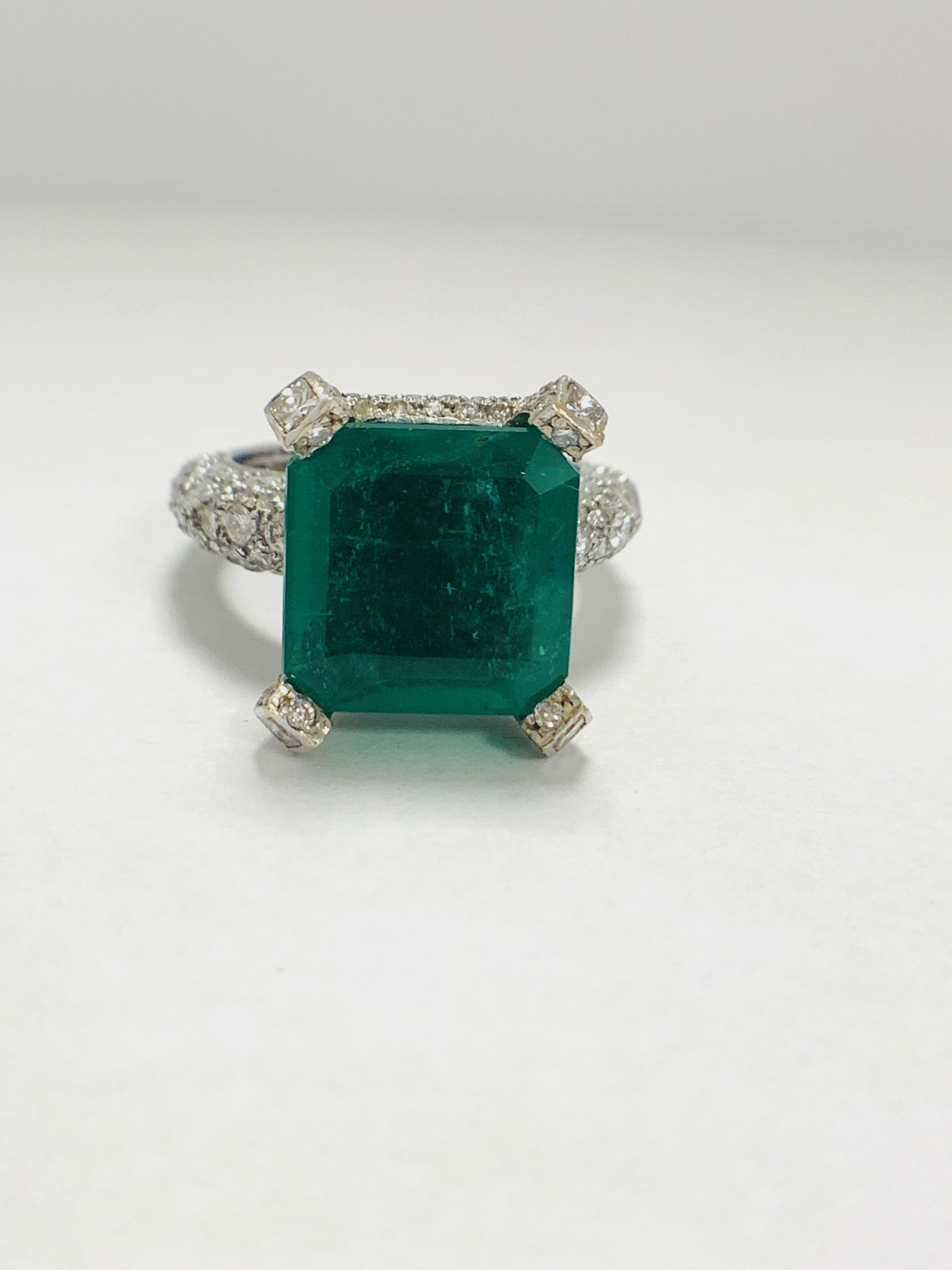 Lot 49 - Platinum Emerald and Diamond ring