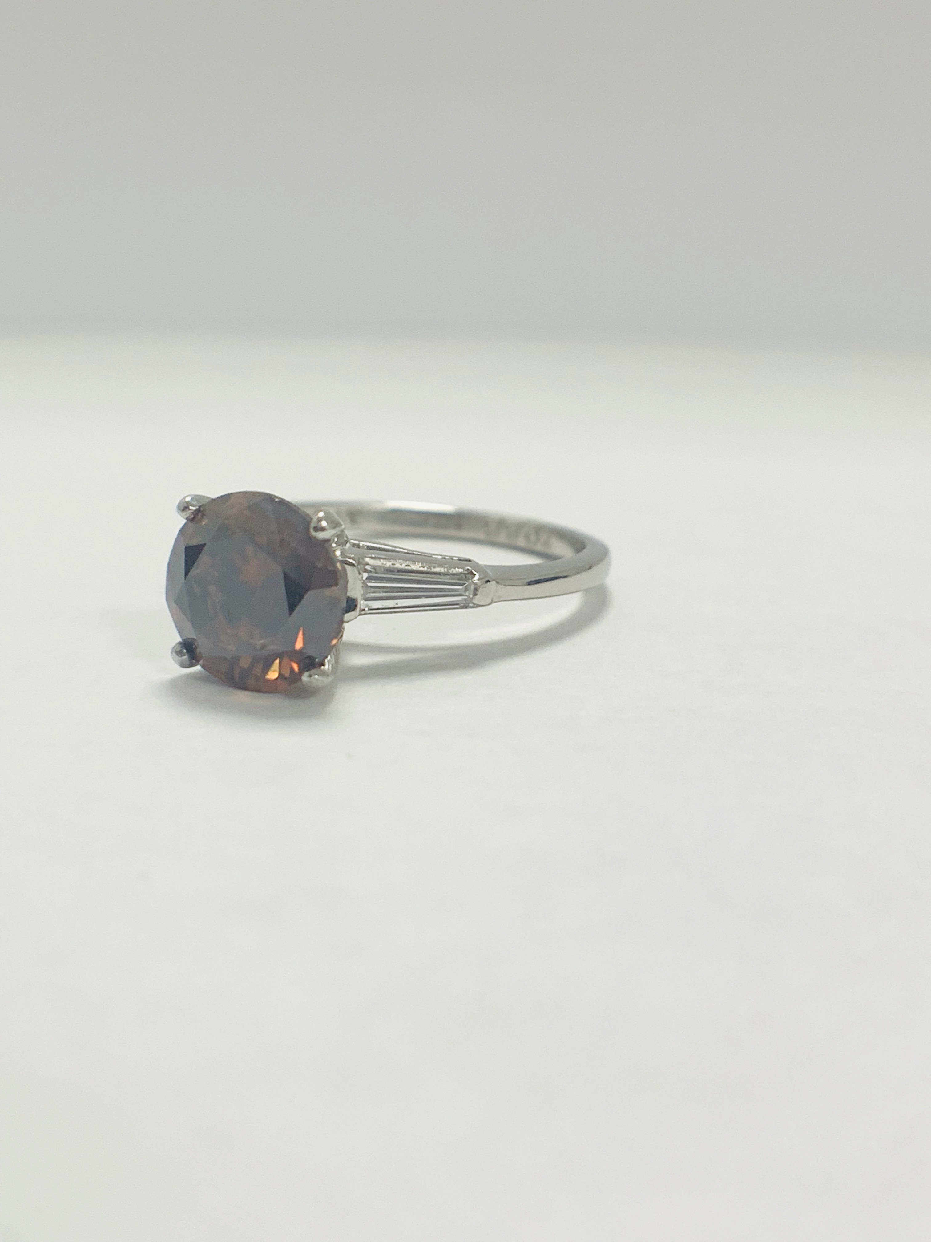 Platinum Diamond ring featuring centre, round brilliant cut, deep orangey brown Diamond (2.15ct) - Image 3 of 14