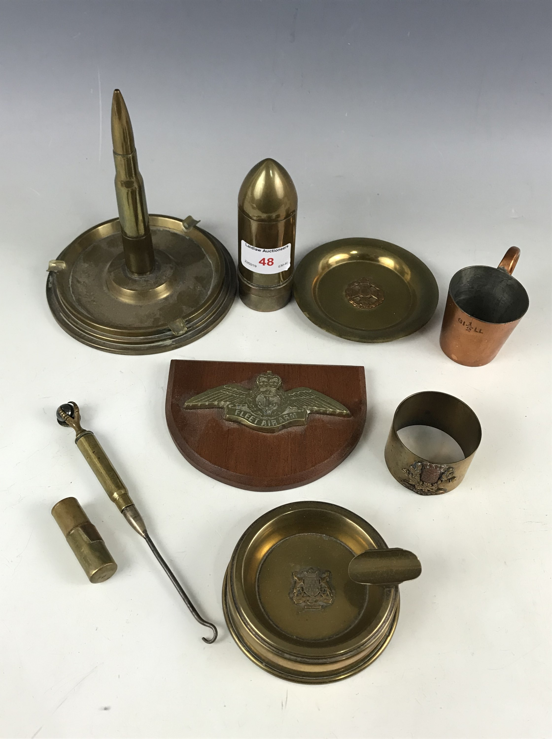 Lot 48 - A quantity of trench art and military metalware including a Pusser's rum measure