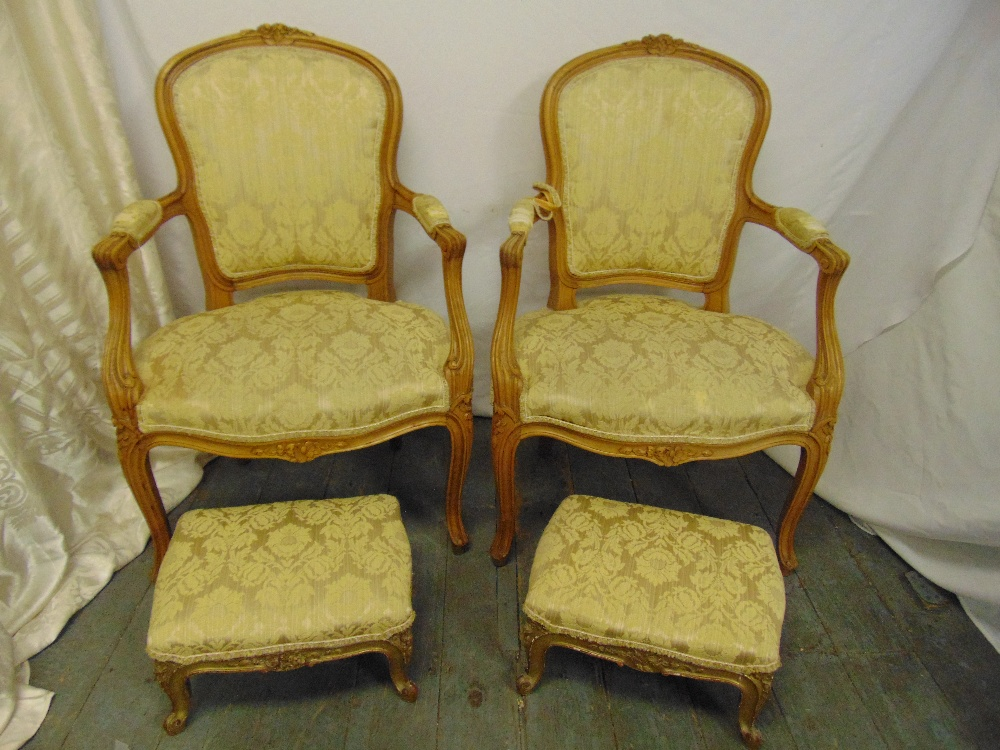 Lot 43 - A pair of French style upholstered armchairs and a pair of matching foot stools
