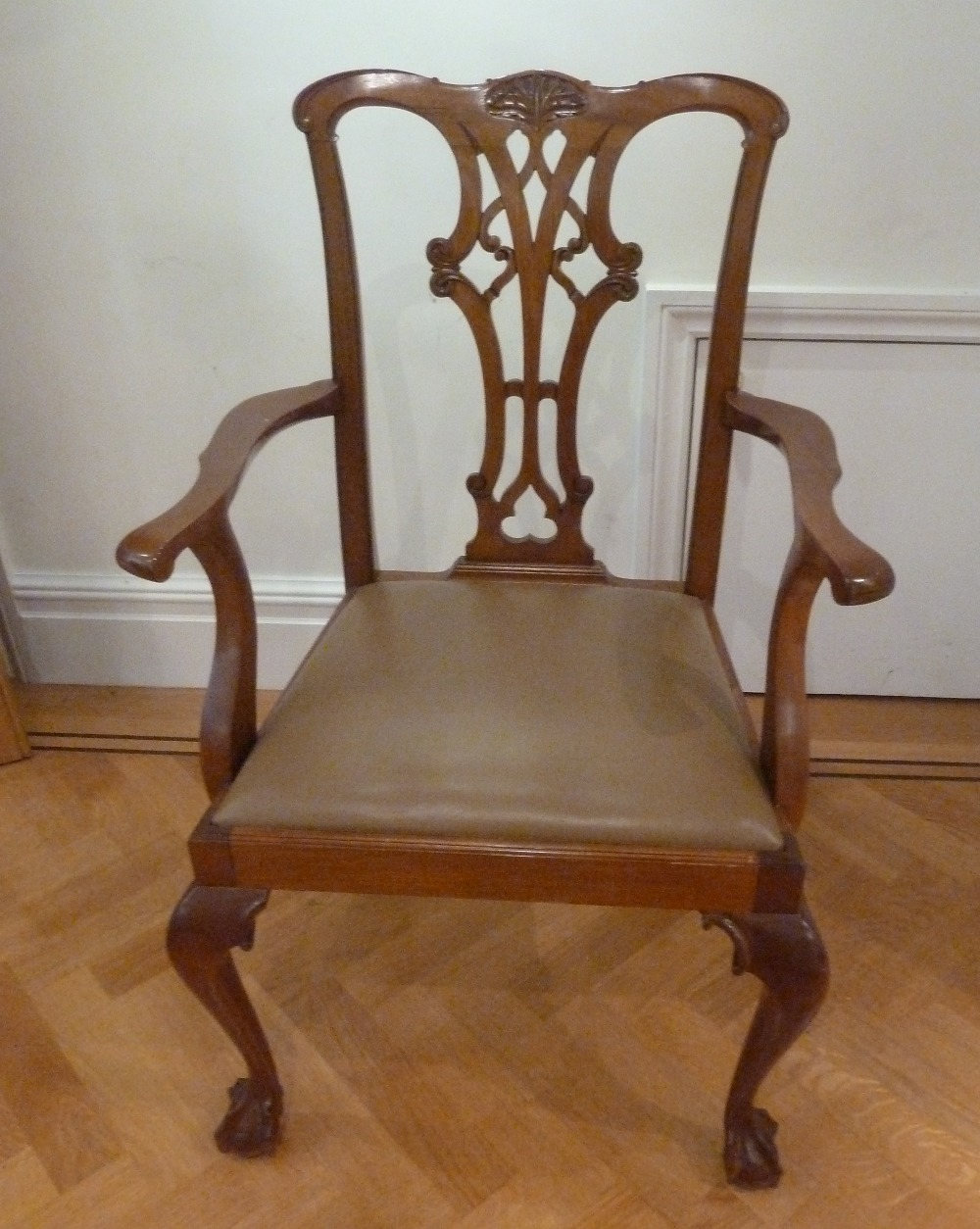 Lot 48 - A Chippendale style mahogany armchair, pierced slatted back and scroll legs