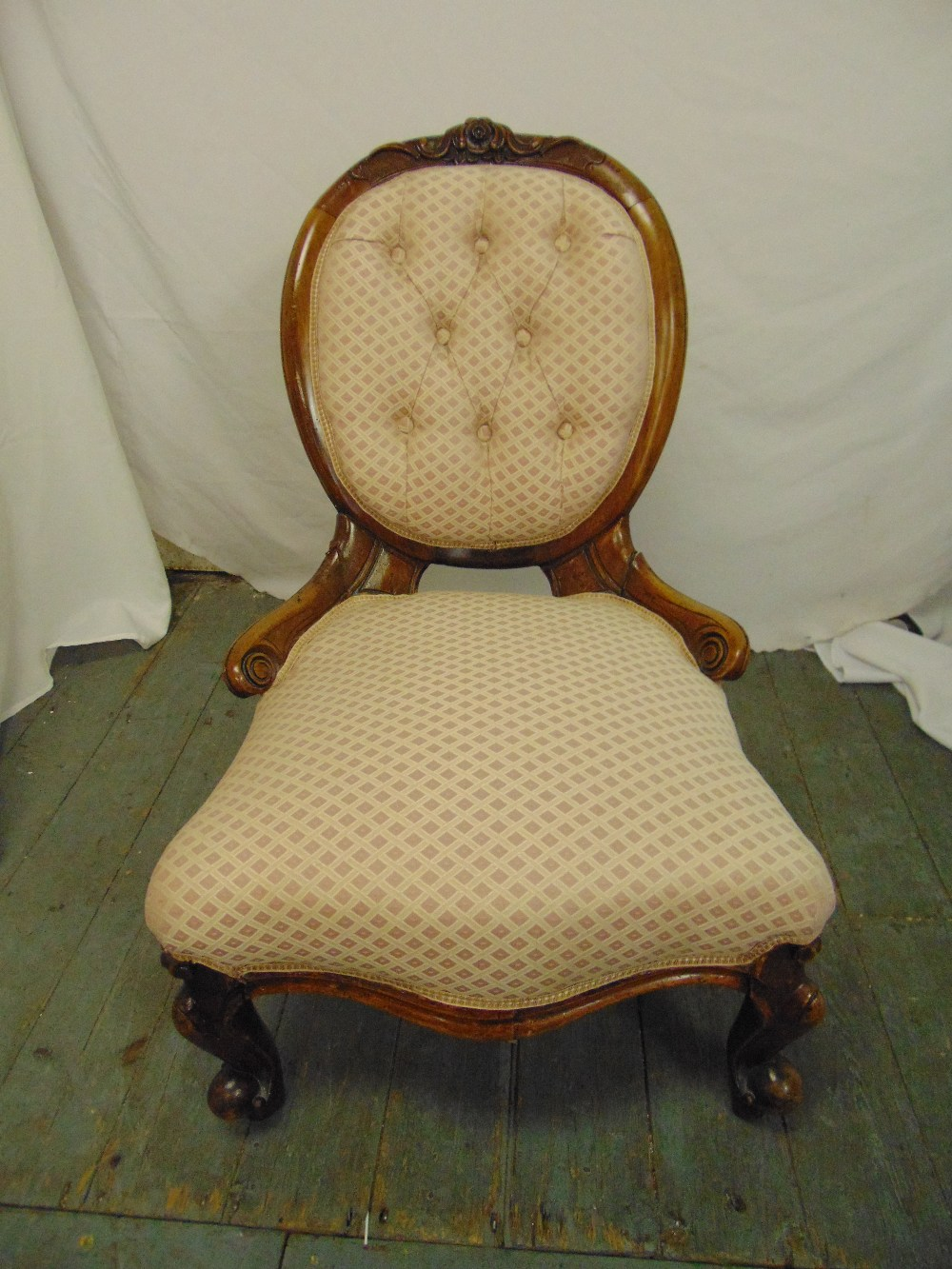 Lot 46 - A Victorian upholstered button back boudoir chair on scroll legs