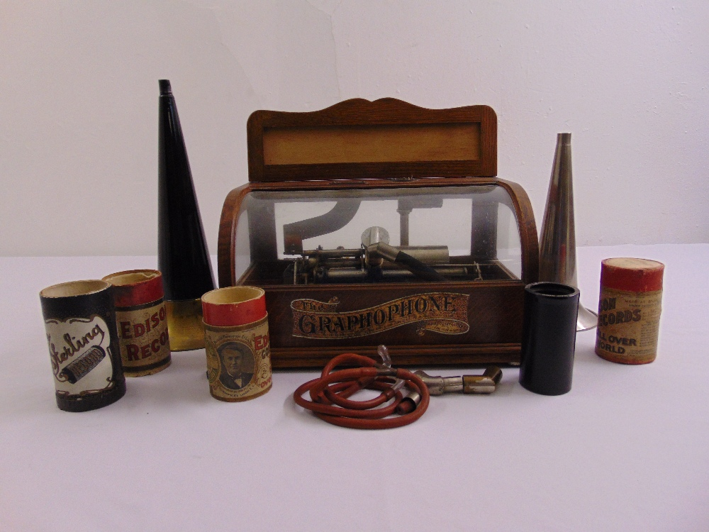 Lot 290 - An Edwardian Columbia phonograph with two detachable horns, original earphones and a cylinder disk