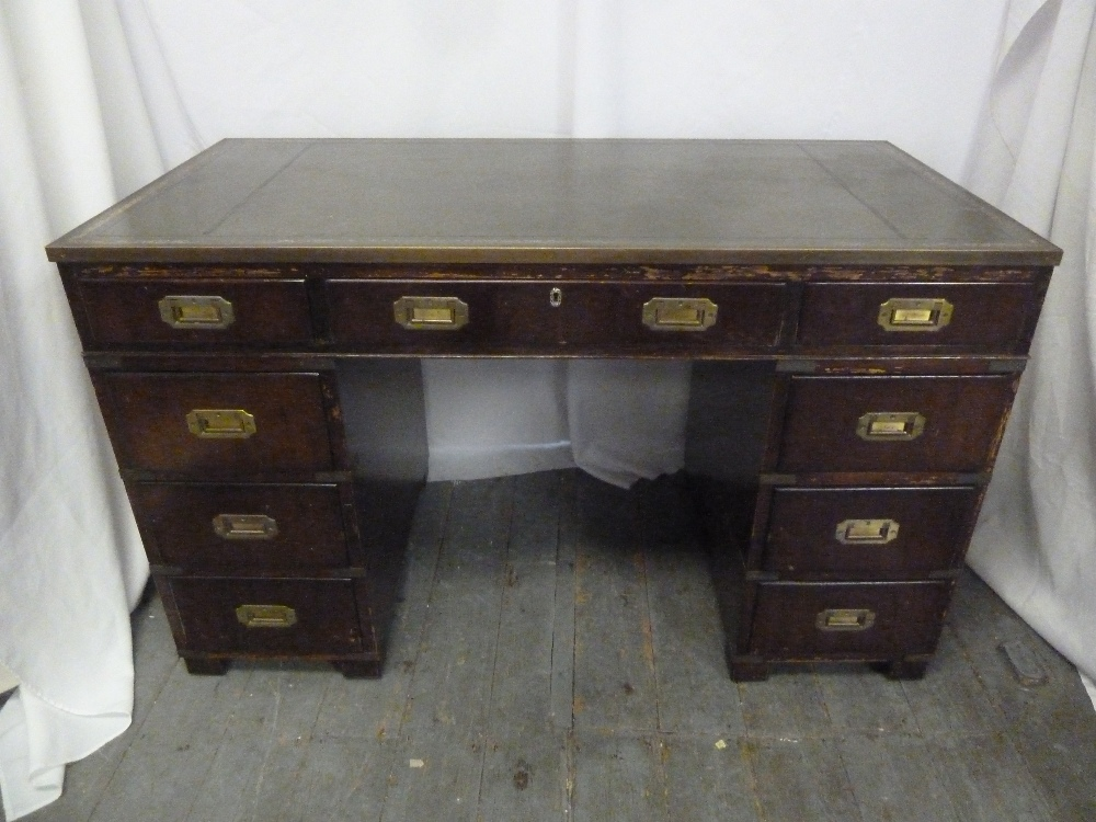 Lot 5 - A rectangular mahogany pedestal desk with inset brass handles and tooled leather top