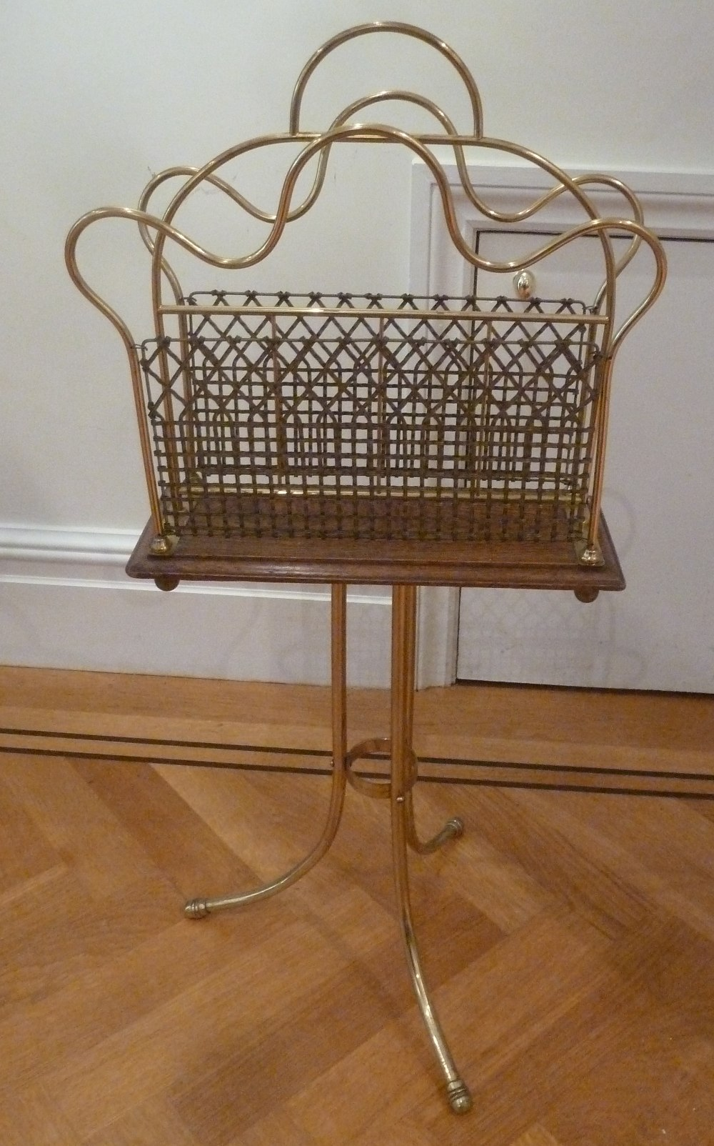 Lot 52 - A brass magazine rack, pierced sides on triform stand with central carrying handle