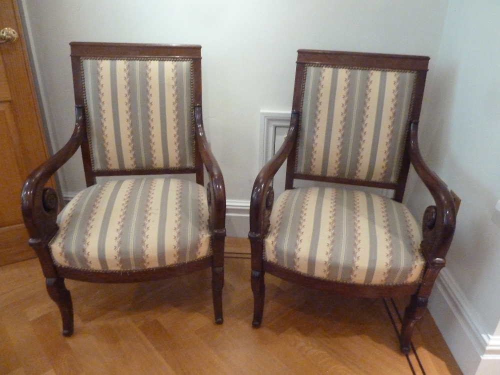 Lot 44 - A pair of mahogany upholstered armchairs with scrolling arms and legs