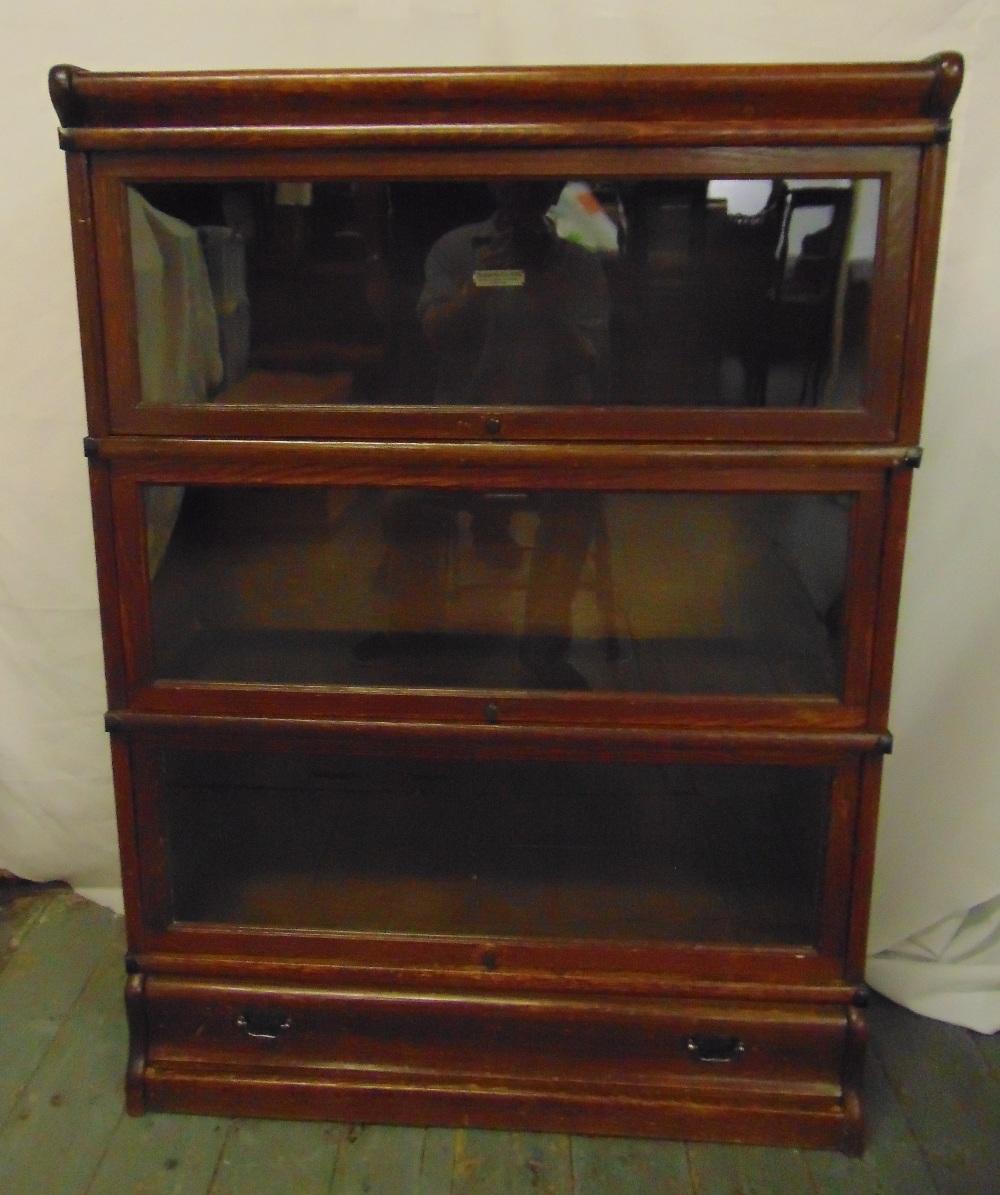 Lot 1 - Globe Wernicke rectangular three section glazed bookcase on single drawer base and top plinth