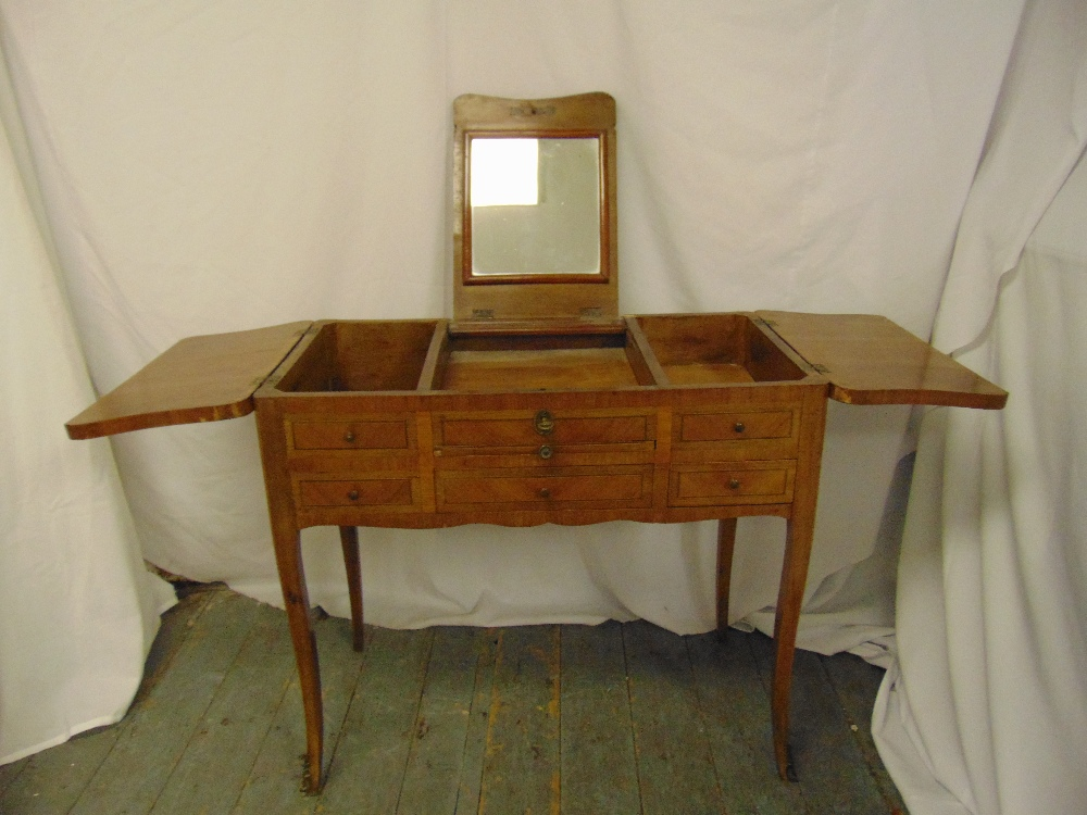 Lot 12 - A rectangular kingswood dressing table, the central section lifts to reveal a dressing table mirror,