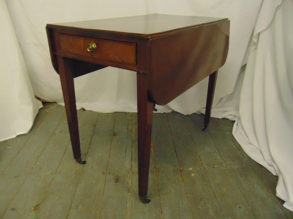 Lot 18 - An Edwardian rectangular mahogany drop flap table with single drawer on four tapering rectangular