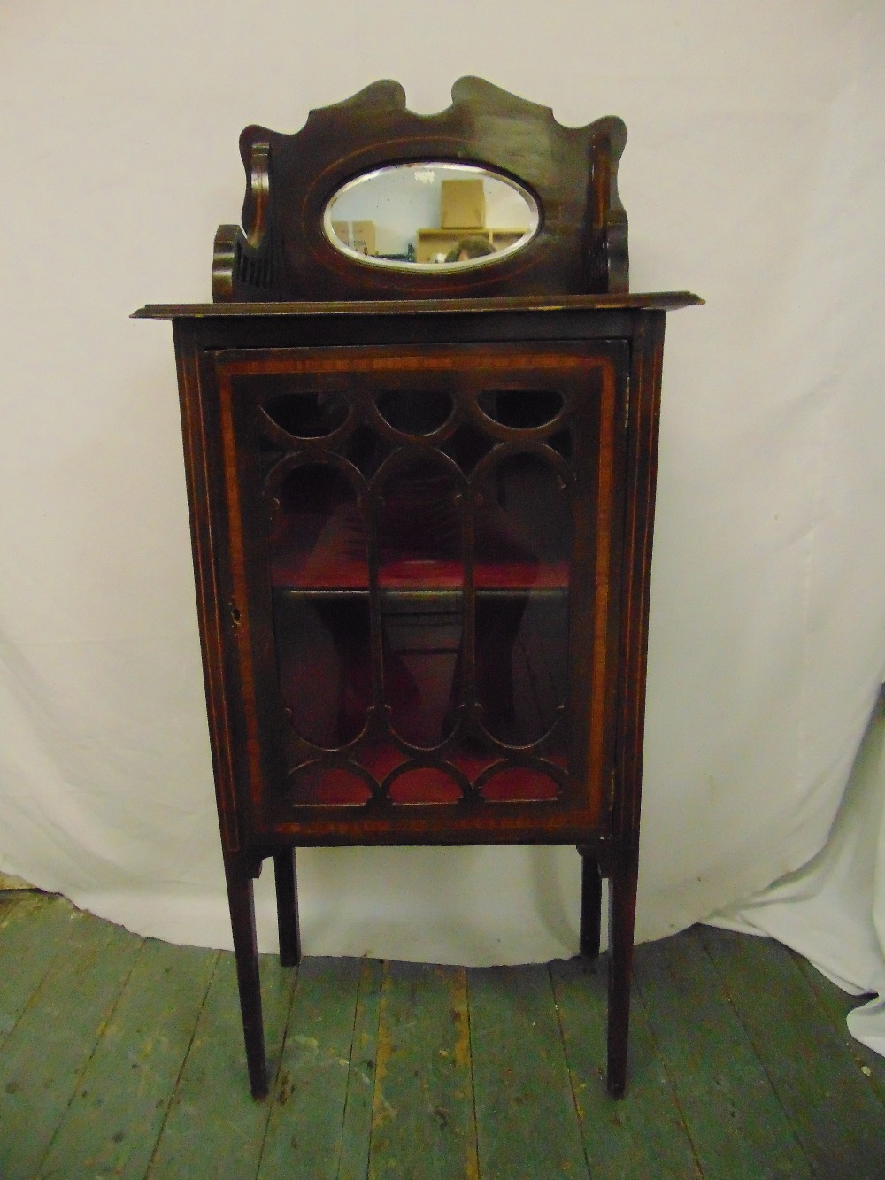 Lot 15 - An Edwardian rectangular mahogany inlaid bow front glazed display cabinet surmounted by an oval