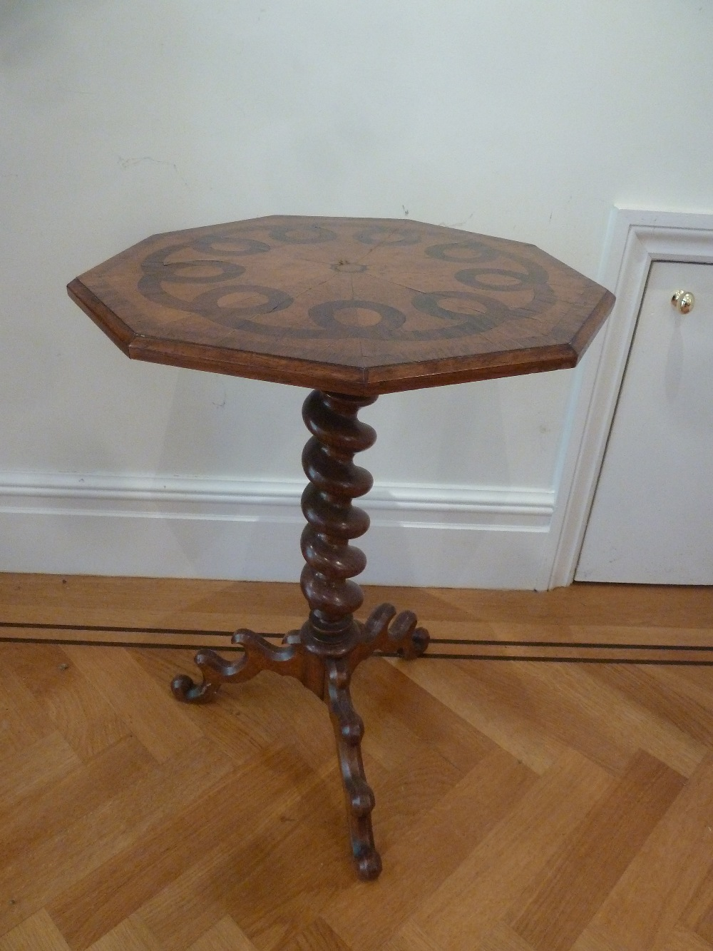 Lot 31 - An inlaid side table with octagonal top on barley twist support with outswept legs