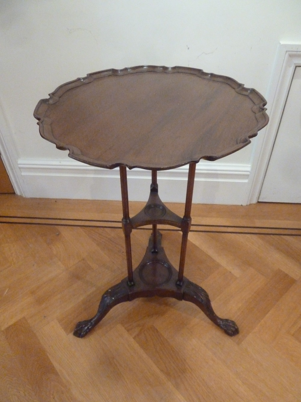 Lot 30 - A mahogany tea table circular Chippendale style border on three outswept legs