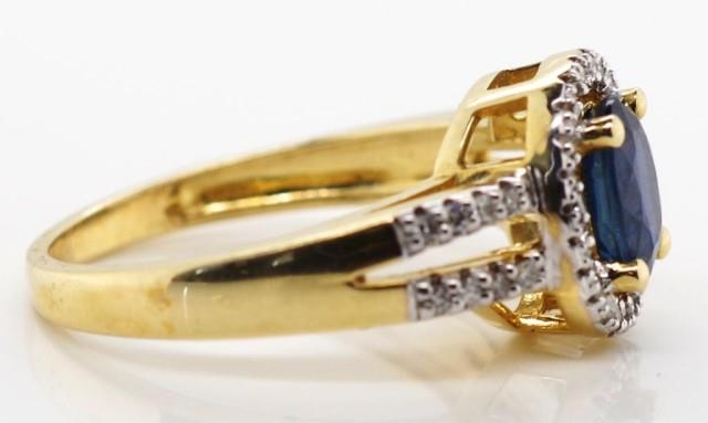 Lot 29 - 14ct gold sapphire and diamond halo ring