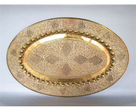 Good Eastern brass oval tray/platter pierced and embossed with fruiting vines, 80 x 53 cm together with 2 contemporary lamps