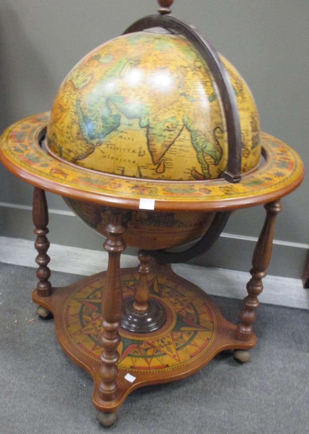 Lot 542 - A Terrestrial globe drinks cabinet - A Terrestrial Globe Drinks Cabinet