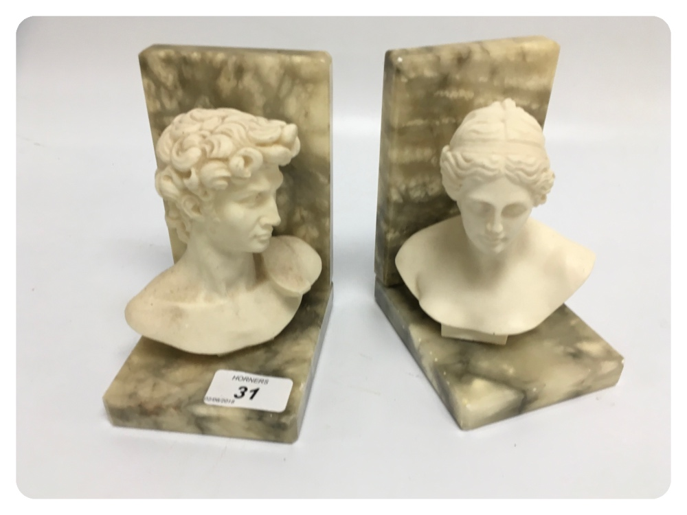 Lot 31 - A PAIR OF CARVED ALABASTER BOOK ENDS, A