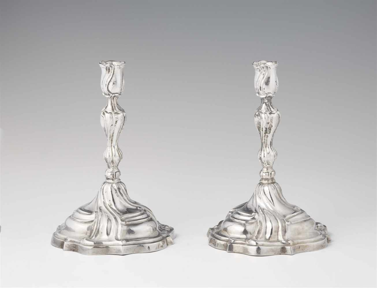 A pair of Augsburg silver candlesticks by Johann HeckenauerRound scalloped base supporting a twist
