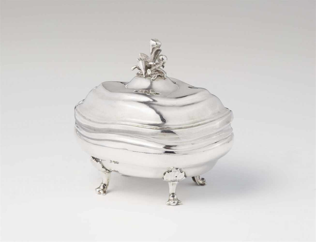 An Augsburg silver sugar boxInterior gilt bombé form box with twist fluting and domed lid with a