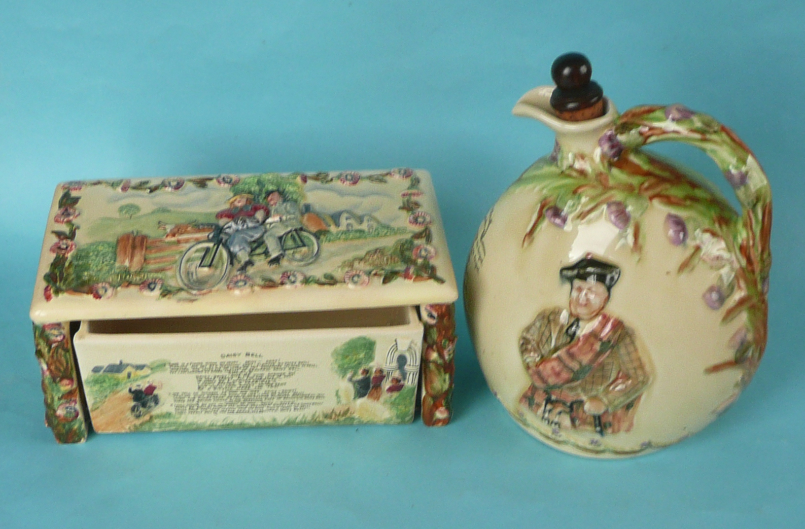 Lot 11 - A good Crown Devon musical cigarette box to play Daisy Bell, 211mm wide and a good spirit flask to