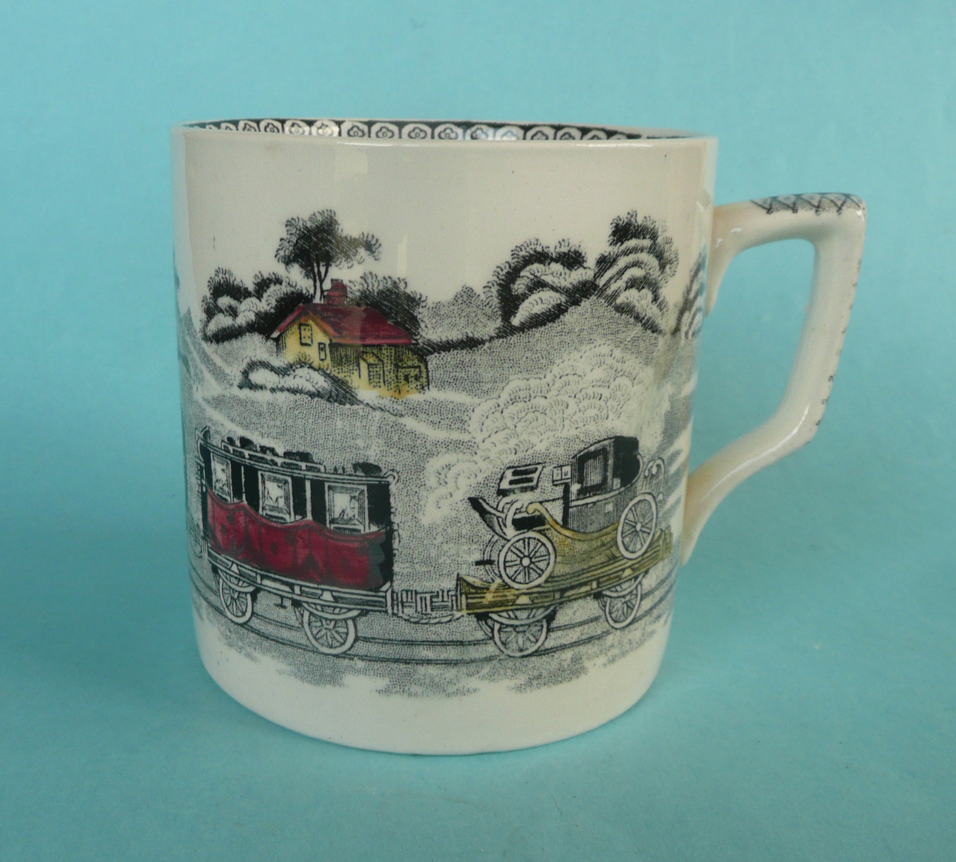 Lot 21 - Railways: a 19th century cylindrical pottery mug printed in black and decorated in yellow and red
