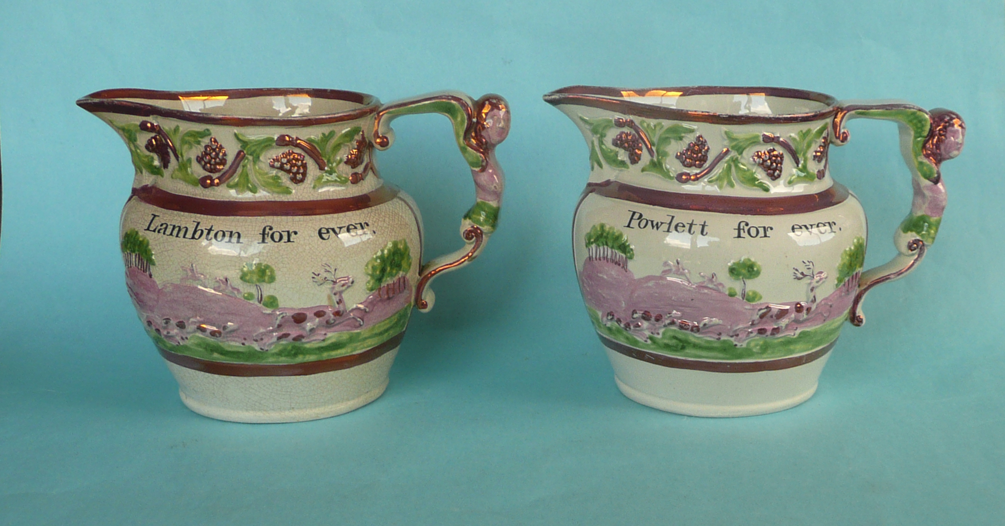 Lot 33 - 1820 General Election: a rare pair of pink lustre jugs set with elaborate figural handles the bodies