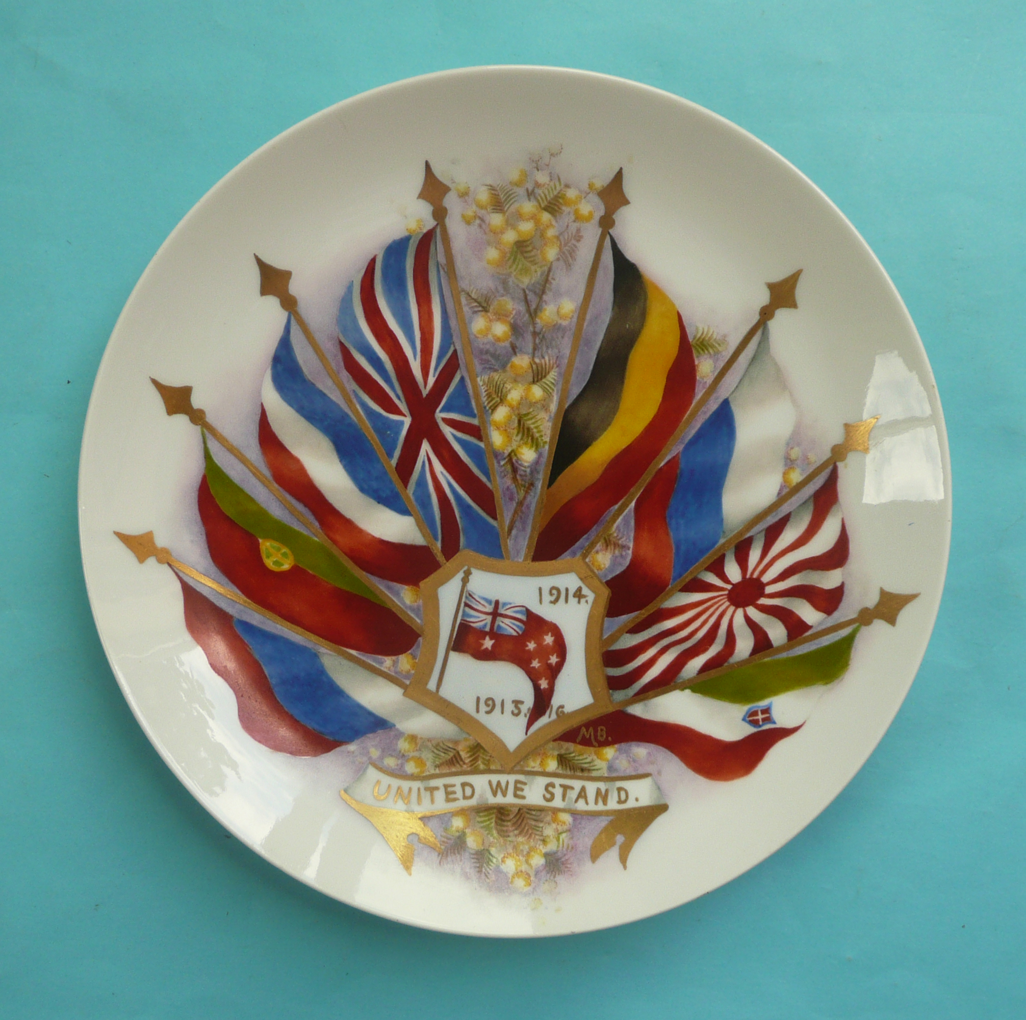 Lot 54 - World War I: a plate by Rosenthal decorated with flags in colours and gilt dated 1914-1915 (