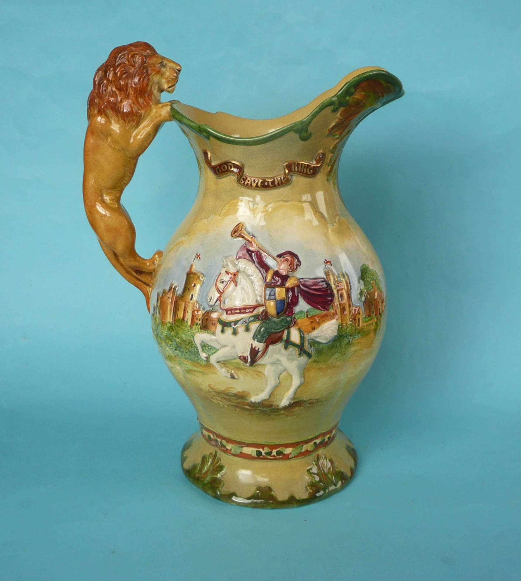 Lot 18 - A good George VI coronation musical moulded jug impressively decorated in colours and gilt to play