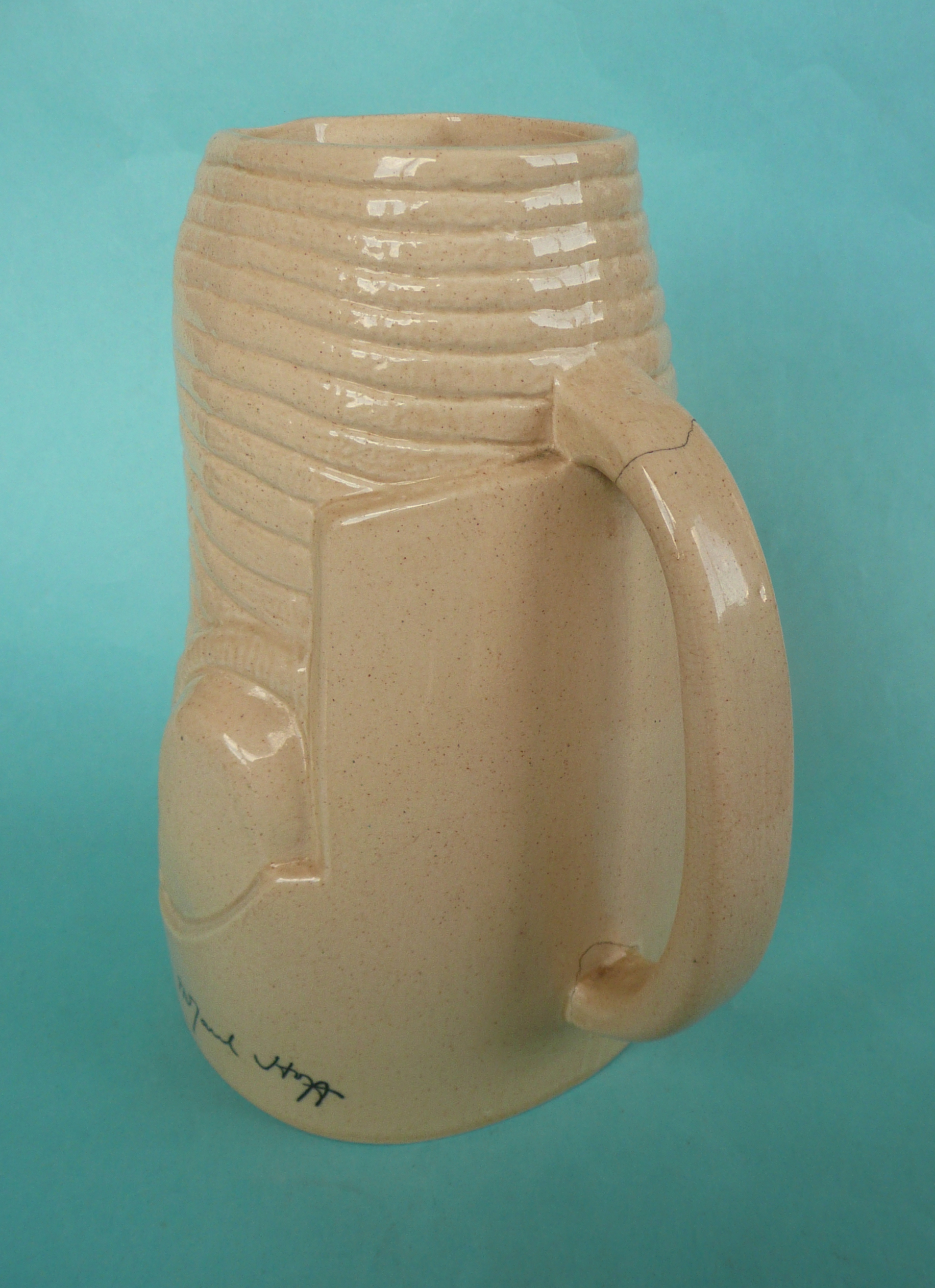 Lot 37 - Sir Douglas McGarel Hogg: an Ashstead pottery jug by Percy Metcalfe moulded with name and printed