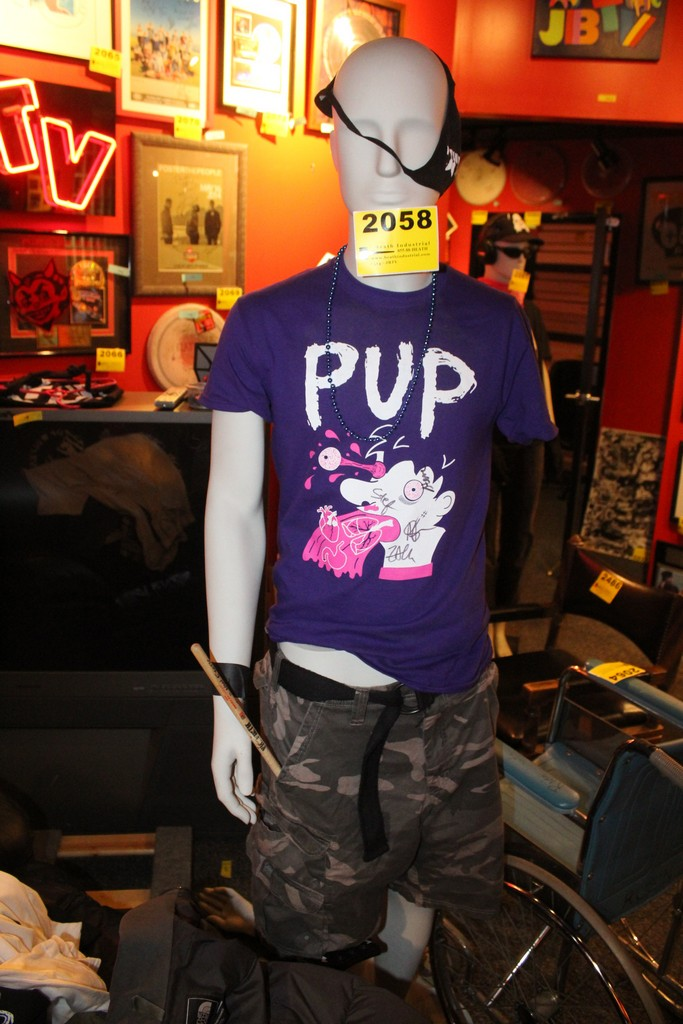 Mannequin Wearing Pup Signed T-Shirt