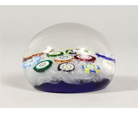A PERTHSHIRE GLASS MILLEFIORI PAPERWEIGHT. Design PP12. 2.5ins diameter.