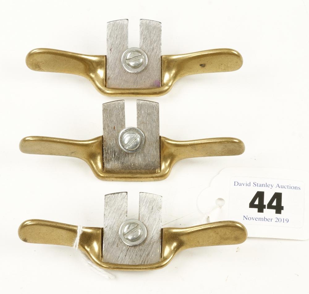 "Lot 44 - Three miniature brass spokeshaves 3 3/4"" o/a G++"