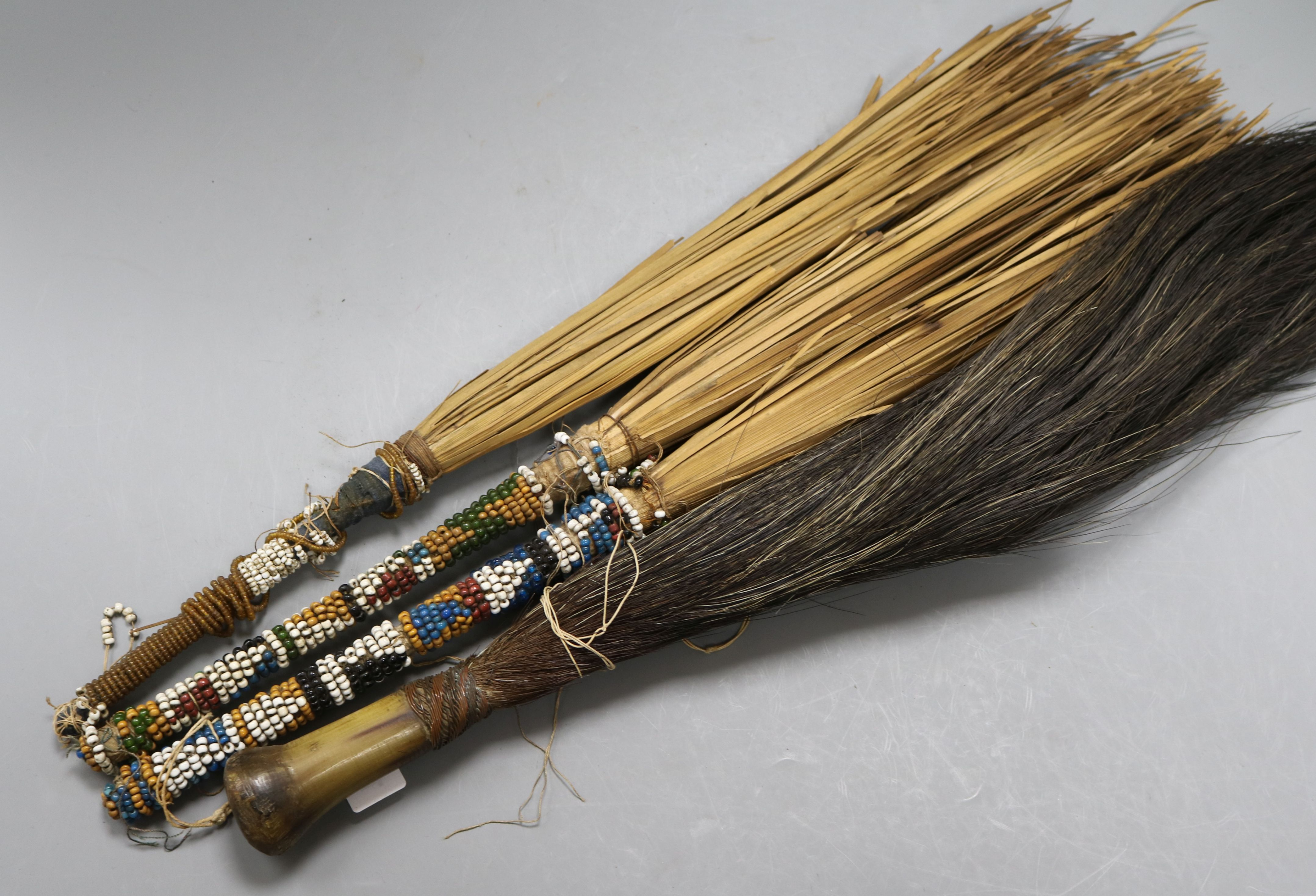 Lot 148 - Four African fly whisks
