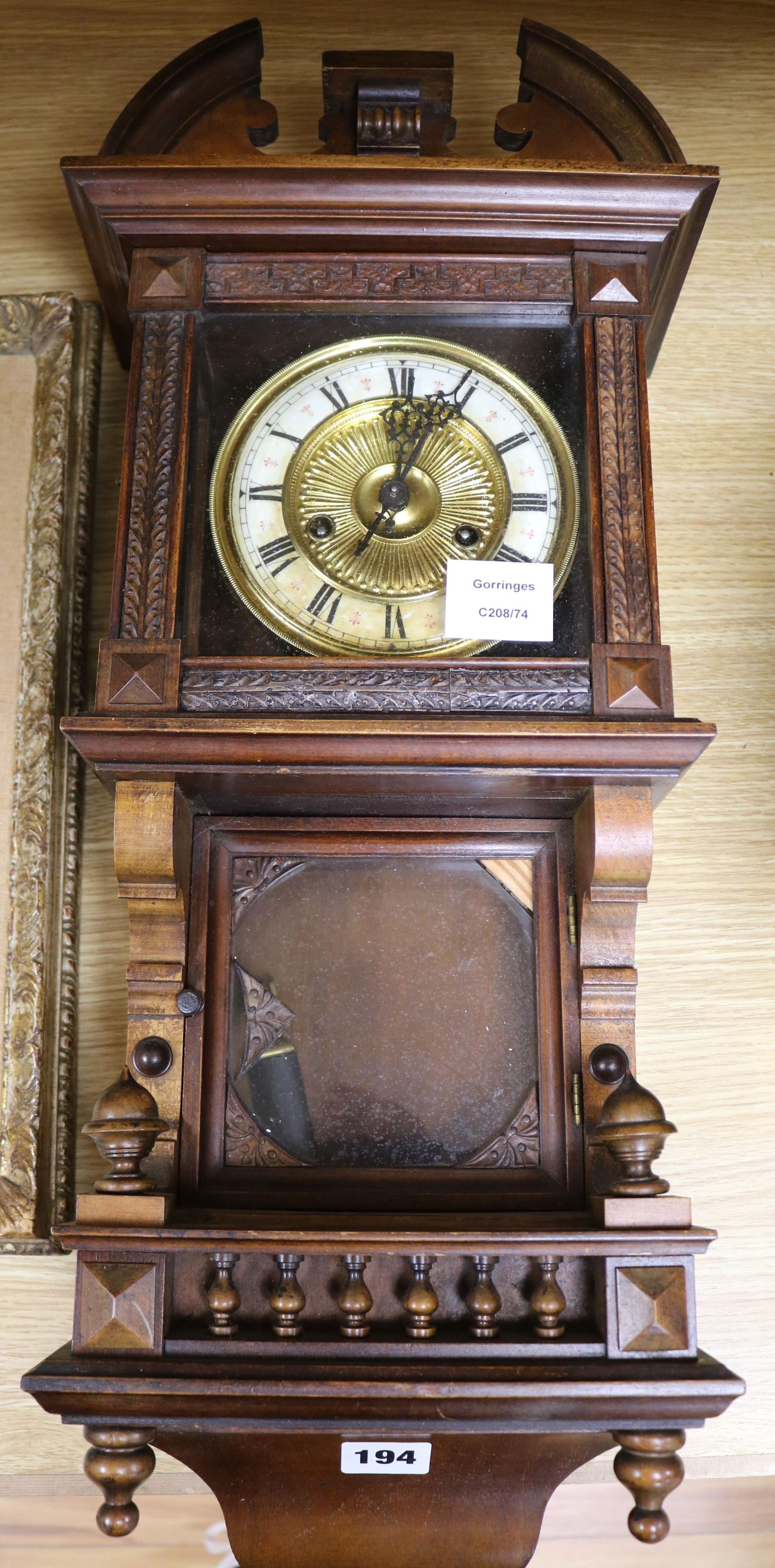 Lot 194 - A late Victorian walnut eight day wall clock