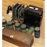 A magic lantern, lantern slides and six phonograph cylinders
