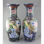 A pair of large Chinese blue ground 'dragon and phoenix' vases, 19th century, painted with dragons