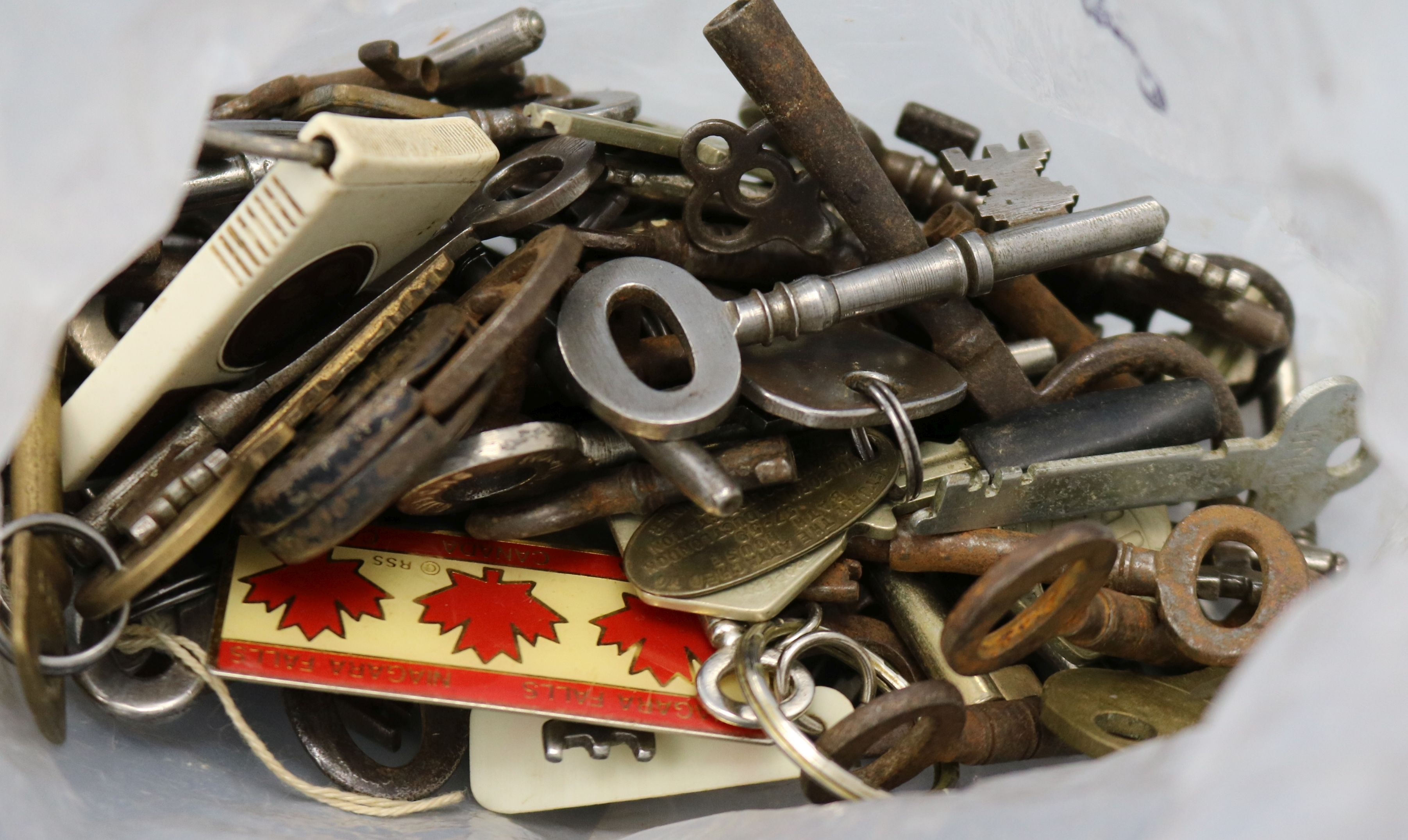 Lot 303 - A box of 18th/20th century keys from interesting old buildings including the key to a bible box at