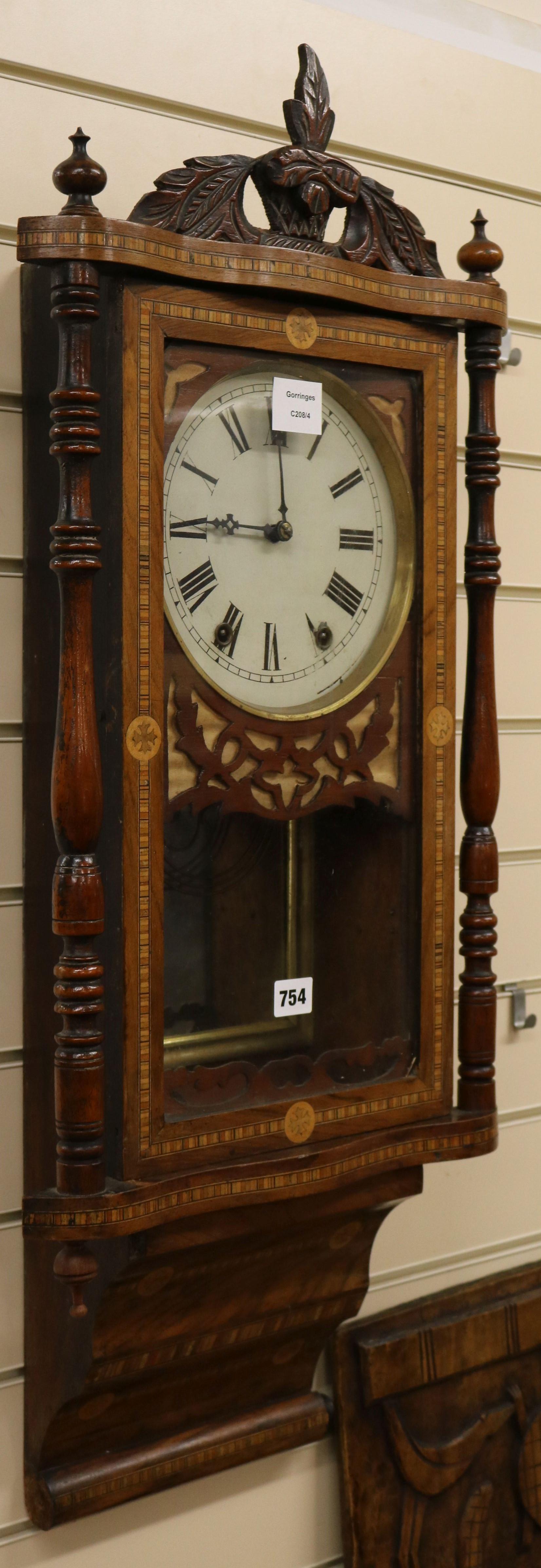 Lot 754 - A late Victorian inlaid walnut eight day wall clock W.39cm