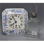 A German porcelain clock and a silver mounted decanter