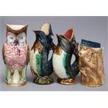 Two ceramic fish jugs, one owl and a monkey