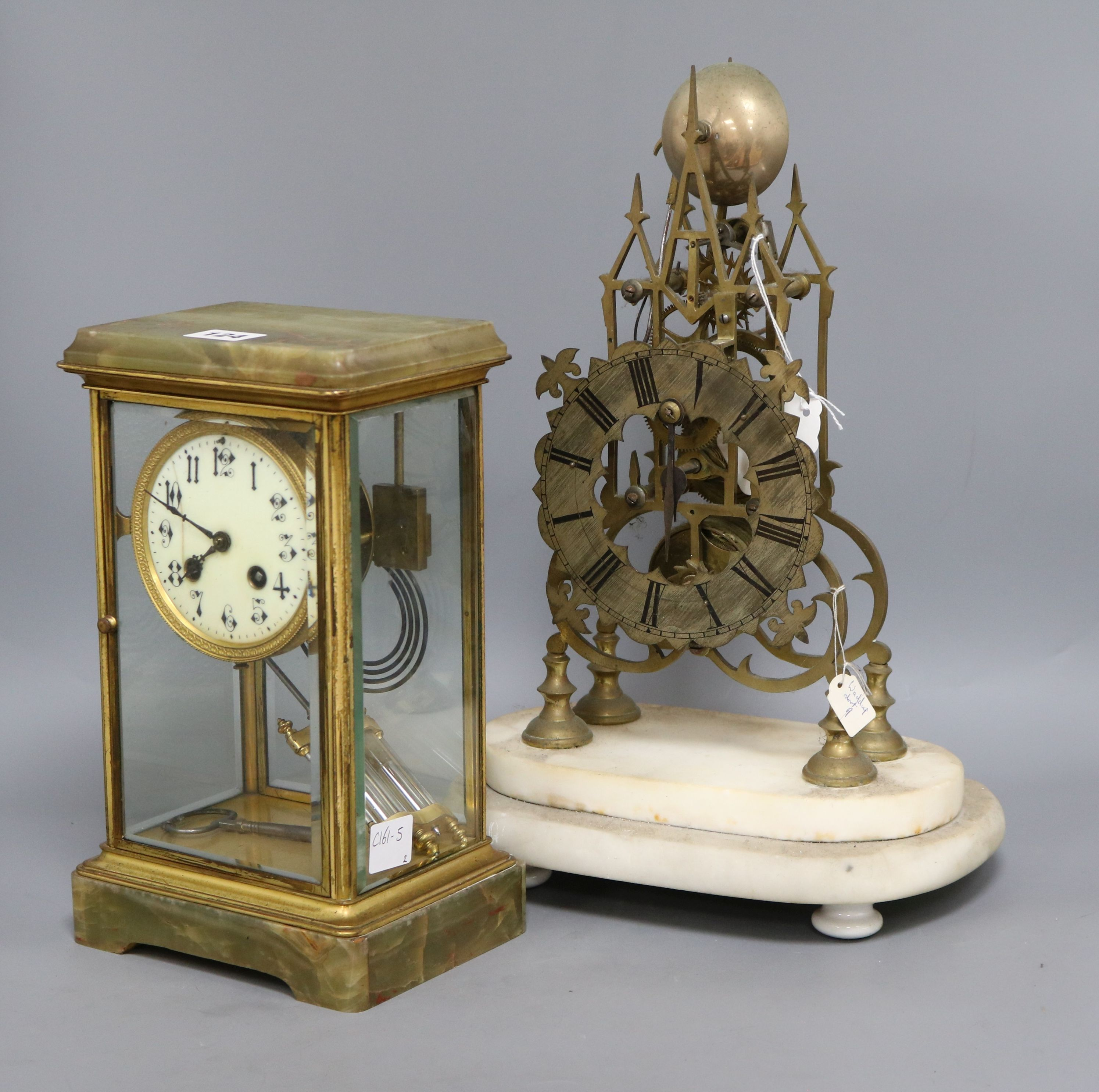 Lot 124 - An onyx four glass clock and a skeleton clock