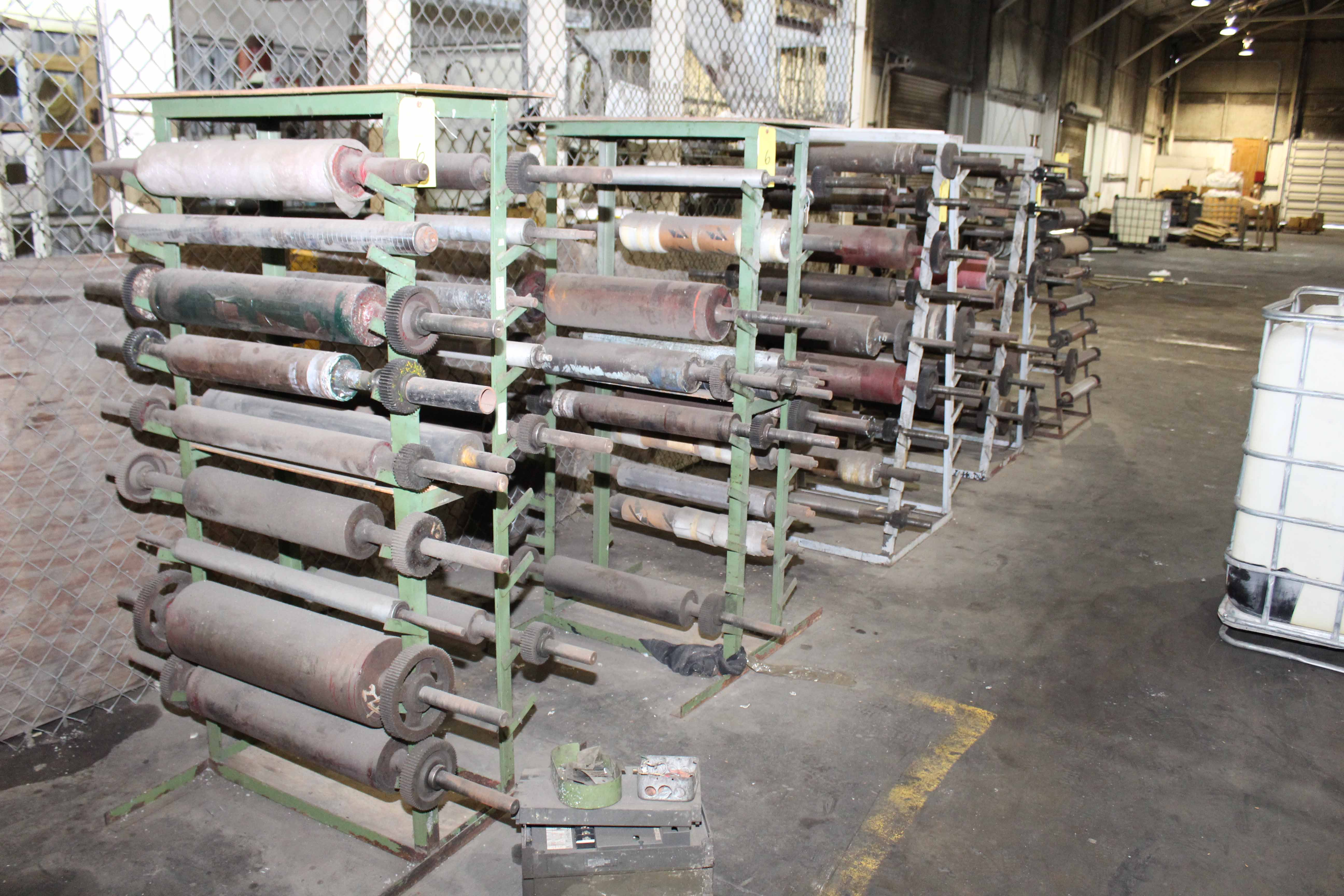 Lot 6 - LOT OF (8) A-FRAME RACKS CONTAINING RUBBER AND METAL ROLLS, spare rolls for blown film/printing