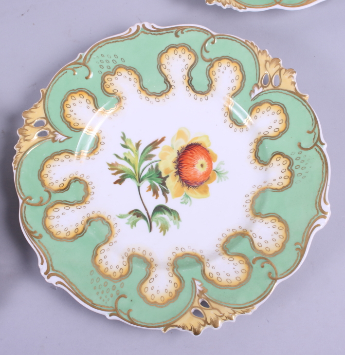 Lot 59 - A 19th century part dessert service with botanical decoration (restoration to one plate)
