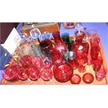A set of six cranberry glass wines, six cranberry glass pony tumblers, two cranberry jugs and