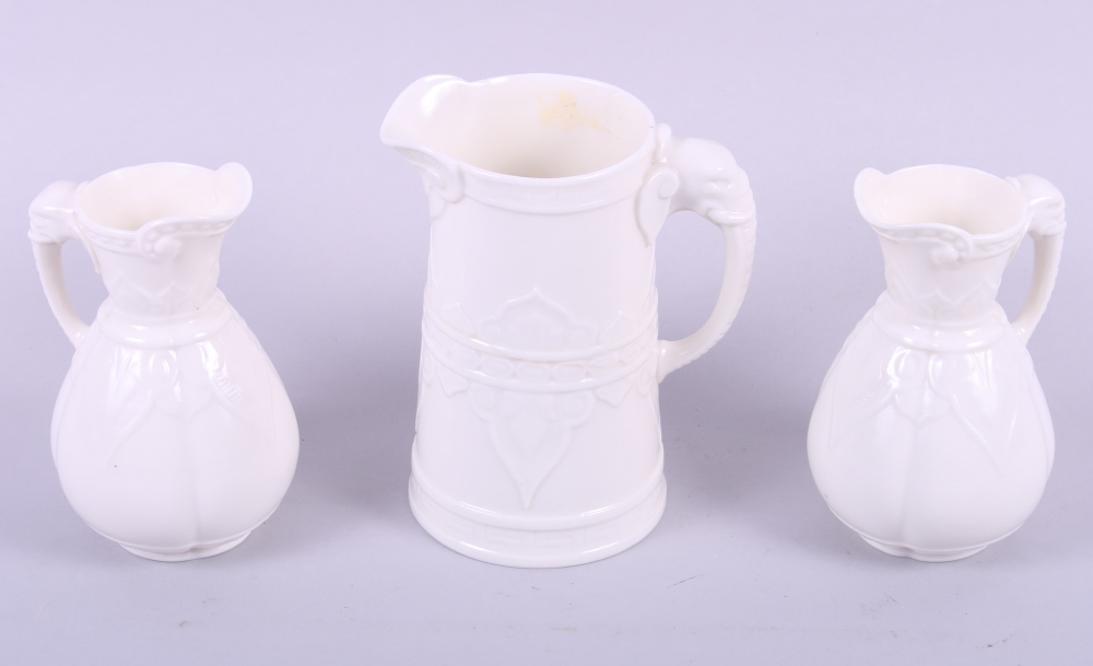 "Lot 27 - Three late 19th century Worcester ""Ivory"" vase jugs with elephant head handles"