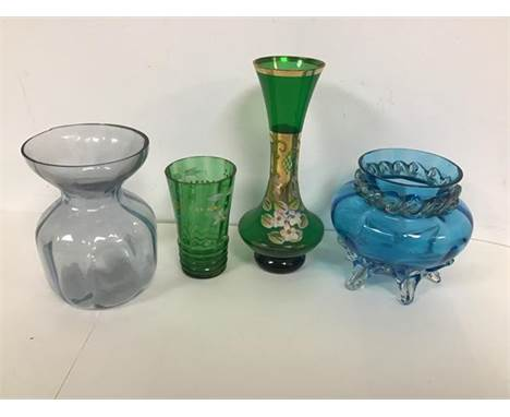 A mixed lot of glassware including a blue glass vase with a faceted edge over a wave motif neck with an urn shaped body on fi