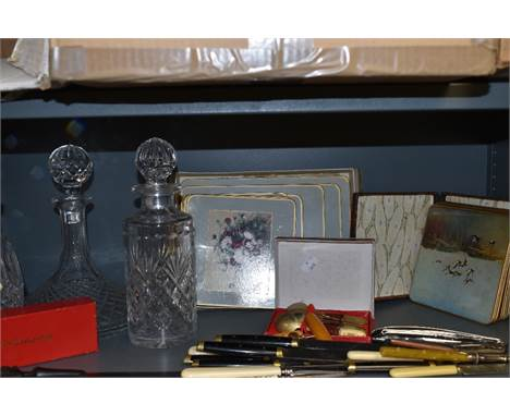 Two Waterford crystal decanters and similar Webb Corbett, also a selection of vintage place mats and cutlery.