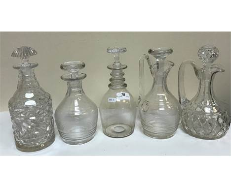 A collection of assorted glassware to include various decanters, drinking glasses, an illusion glass, etc., together with a p