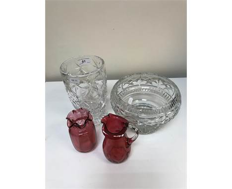 A collection of various cut glass ware to include two fruit bowls one Brierley, two jugs, various drinking glasses to include