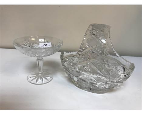 A collection of glassware to include a pair of slab cut jugs raised on pedestal feet, a Bohemian style fruit basket, two frui