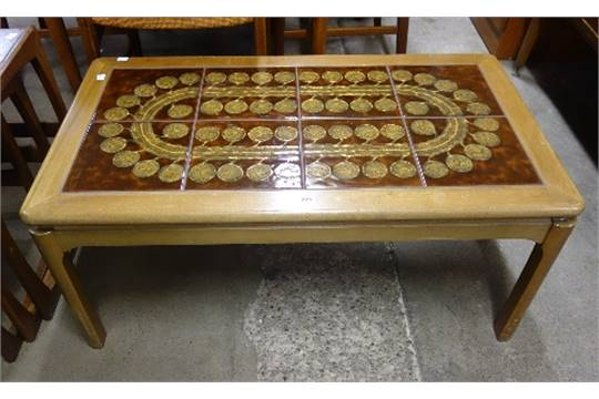 A Nathan teak tiled top coffee table